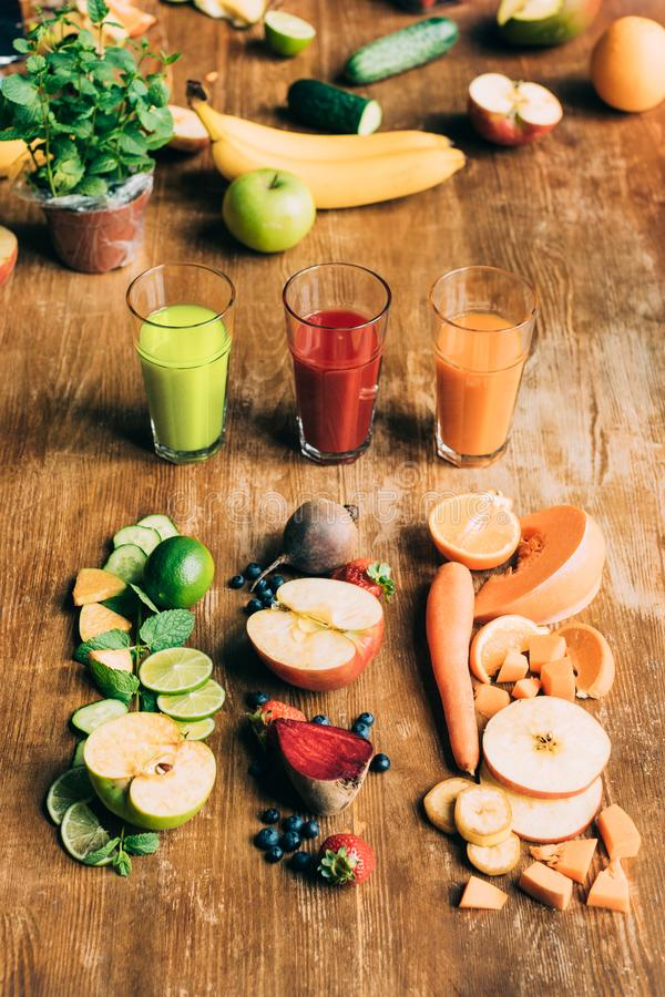 high angle view of various healthy smoothies in glasses and fresh ingredients stock photography