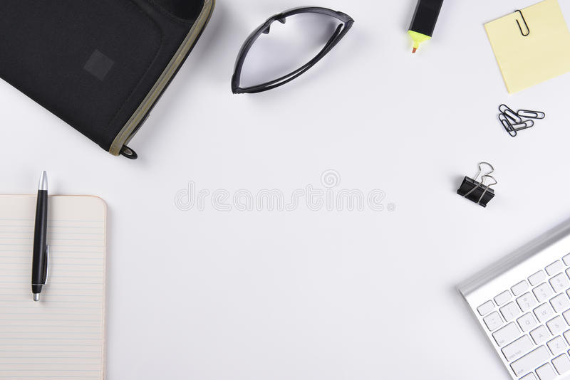 High angle view of a white business desk with pad, pen, keyboard and other accessories stock photos