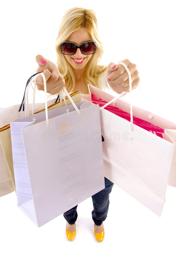 High angle view of woman holding paper bags stock photo