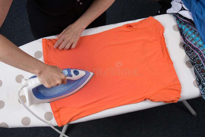 High angle view of woman ironing on ironing board royalty free stock image
