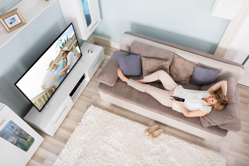 High Angle View Of Woman Watching Television royalty free stock image