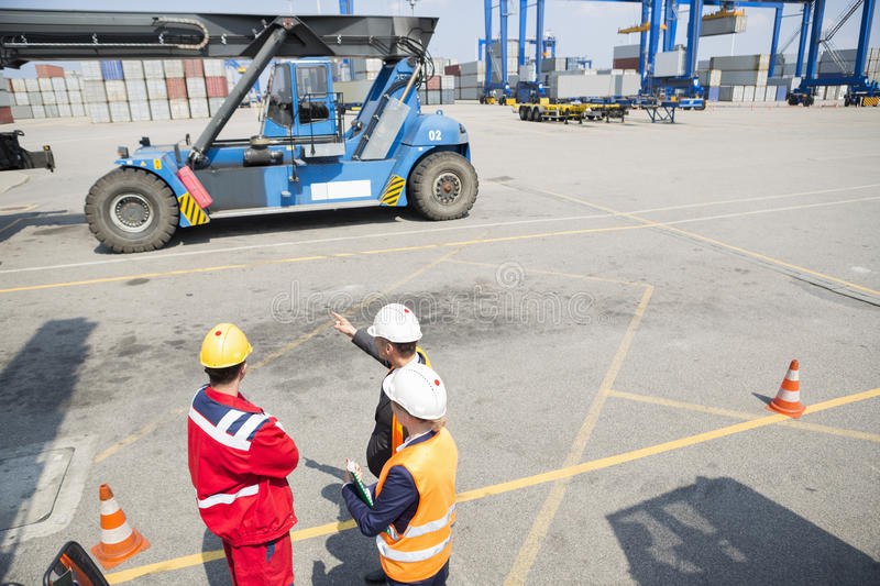 High angle view of workers discussing in shipping yard stock photography
