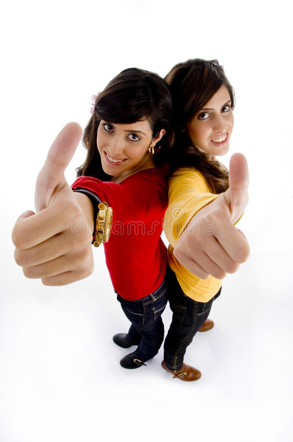 High angle view of young models showing thumb up royalty free stock image
