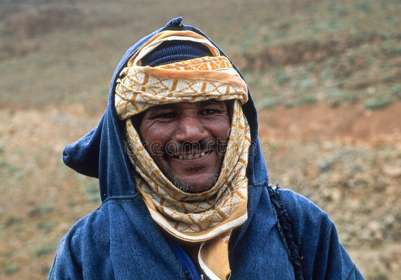 HIGH ATLAS, MOROCCO - AUGUST 21, 2004: Portrait of a moroccan shepherd in traditional clothes royalty free stock image