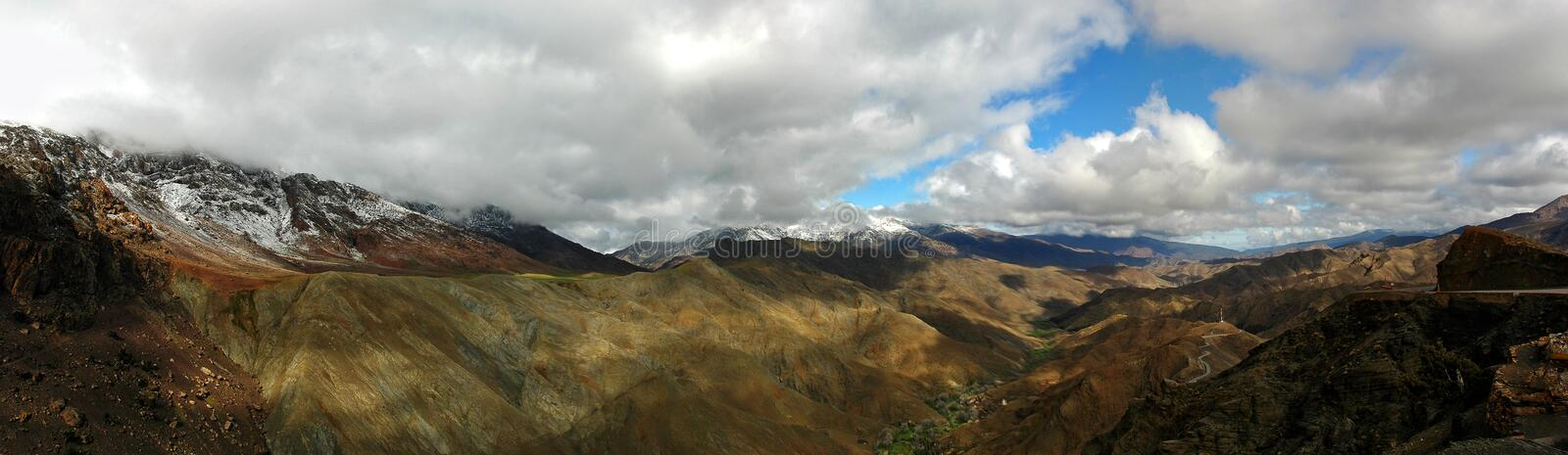 High Atlas panorama. Cloudy nature landscape - panorama of famous mountains High Atlas. Morocco, Africa royalty free stock photos