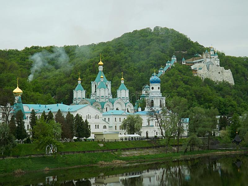 . Landscape with the buildings of the Holy Dormition Lavra and caves on the river bank. royalty free stock photos