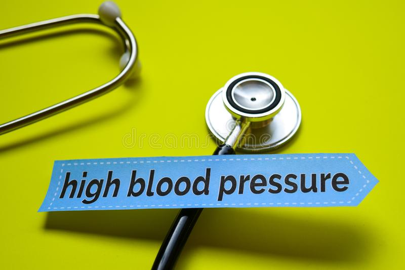 High Blood Pressure with Magnifying glass concept inspiration on yellow background stock photo