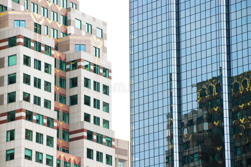 High buildings. Reflections in windows. Close up royalty free stock photo