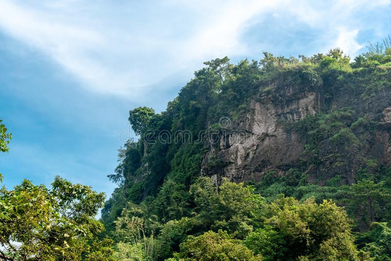 High Cliff Amid Dense and Thick Forest. Hanging Wall Rock Cause by Tectonic Subduction. At Geopark Ciletuh stock photos