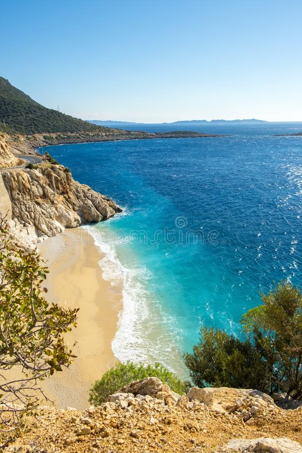 High Clifftop View Empty Turquoise Beach Kaputas. High angle clifftop view of empty turquoise water and white sand beach Kaputas, Turkey royalty free stock images