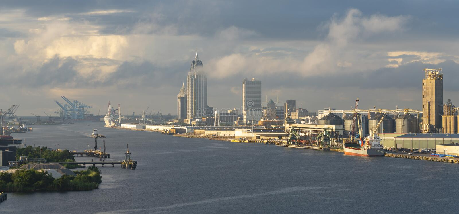 High clouds reflect light on the urban downtown center of Mobile Alabama stock photography