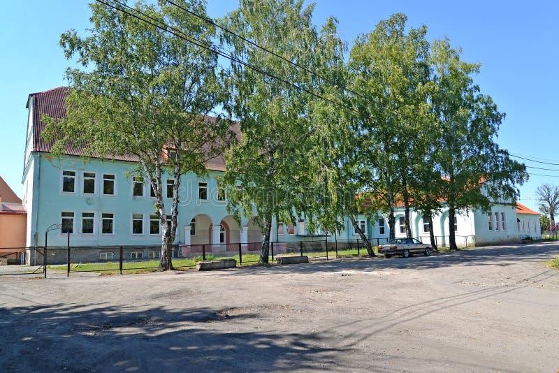 High comprehensive school in summer day. Zheleznodorozhny, Kaliningrad region.  royalty free stock photography