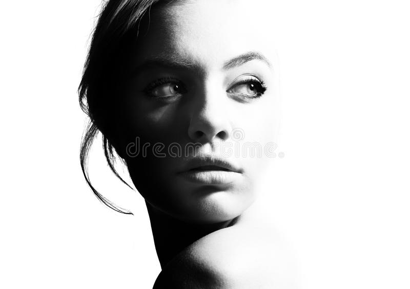High contrast black and white portrait of a beautiful girl. Femininity and beauty, free space for your text royalty free stock photography