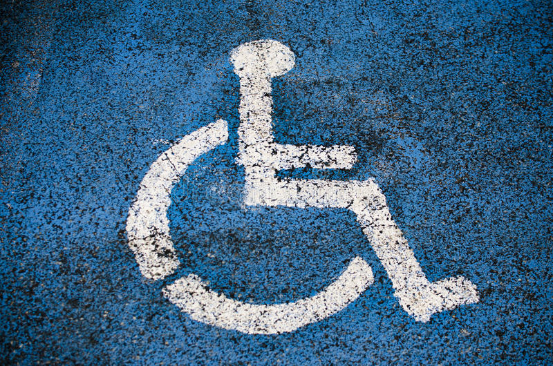 High contrast disabled sign. A vibrant disabled parking sign placed on a parking space stock photos