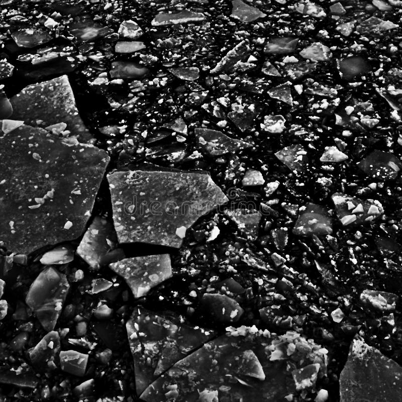 High-contrast ice on water texture stock image