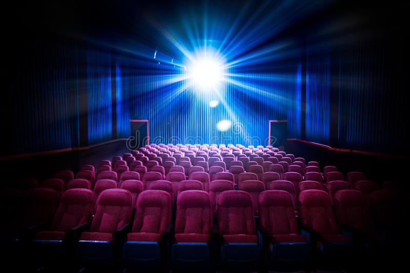 High contrast image of empty movie theater seats stock photography