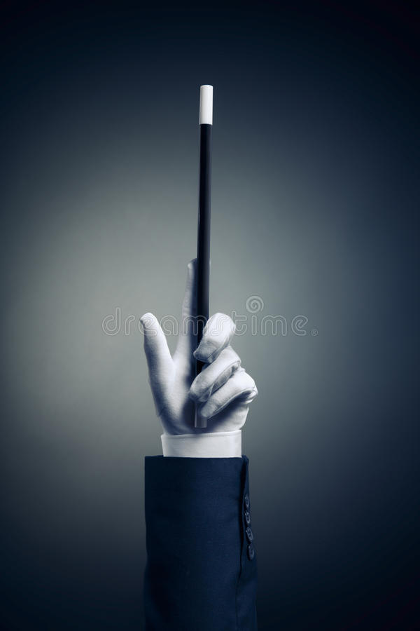 High contrast image of magician hand with magic wand royalty free stock photo