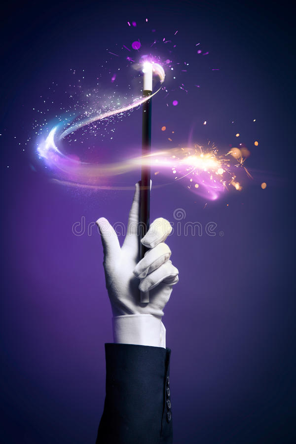 High contrast image of magician hand with magic wand. Magician hand with magic wand royalty free stock photos