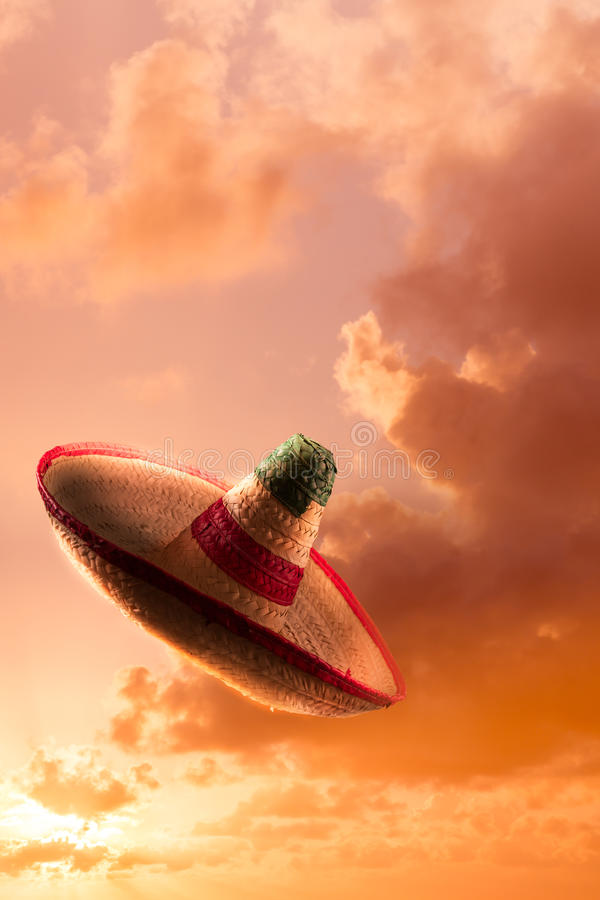 High contrast image of Mexican hat / sombrero in the sky. Mexican sombrero in a dramatic orange sky royalty free stock photos