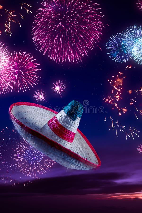 High contrast image of Mexican hat / sombrero in the sky with fireworks. Mexican sombrero with fireworks at night royalty free stock image
