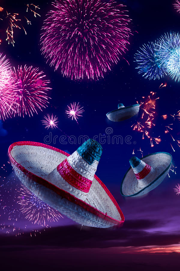 High contrast image of Mexican hats / sombreros in the sky with. Mexican sombreros with fireworks at night royalty free stock photography