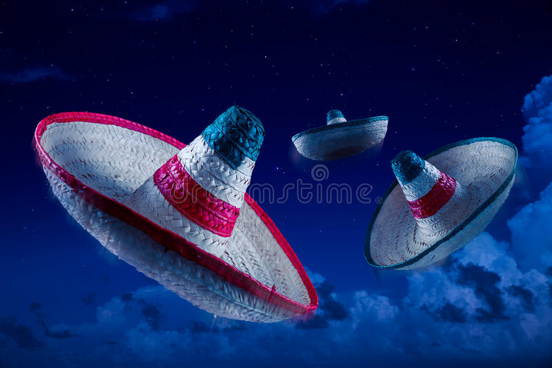 High contrast image of Mexican hats / sombreros in the sky at ni. Mexican sombreros in the sky at night royalty free stock images