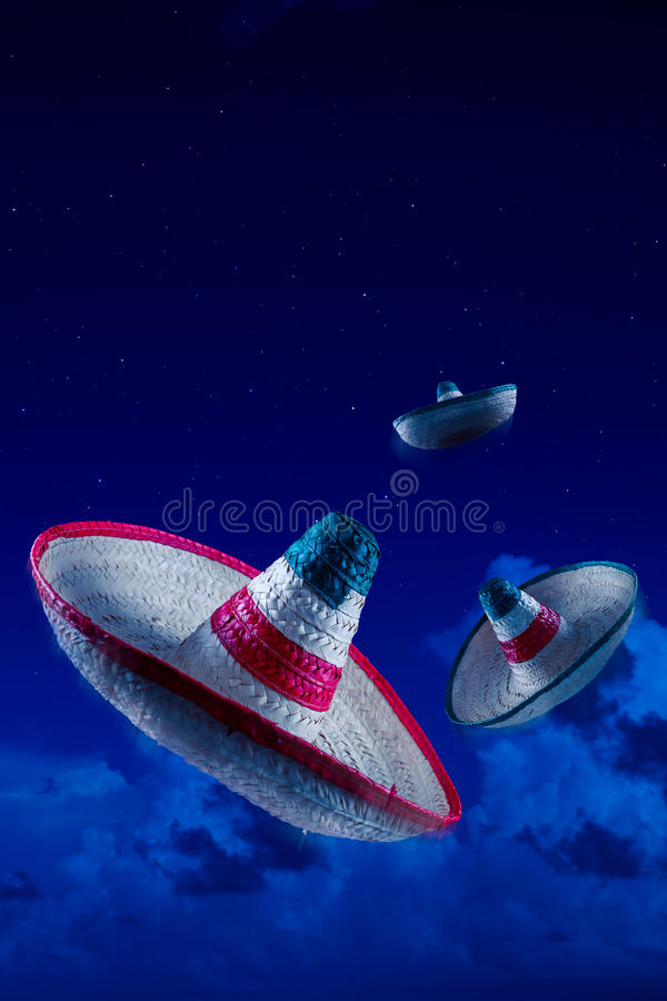 High contrast image of Mexican hats / sombreros in the sky at ni. Mexican sombreros in the sky at night royalty free stock photos