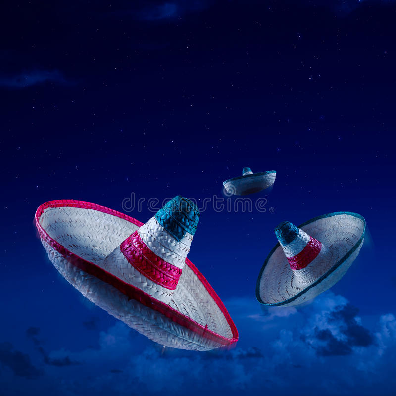 High contrast image of Mexican hats / sombreros in the sky at ni. Mexican sombreros at night, square format royalty free stock images