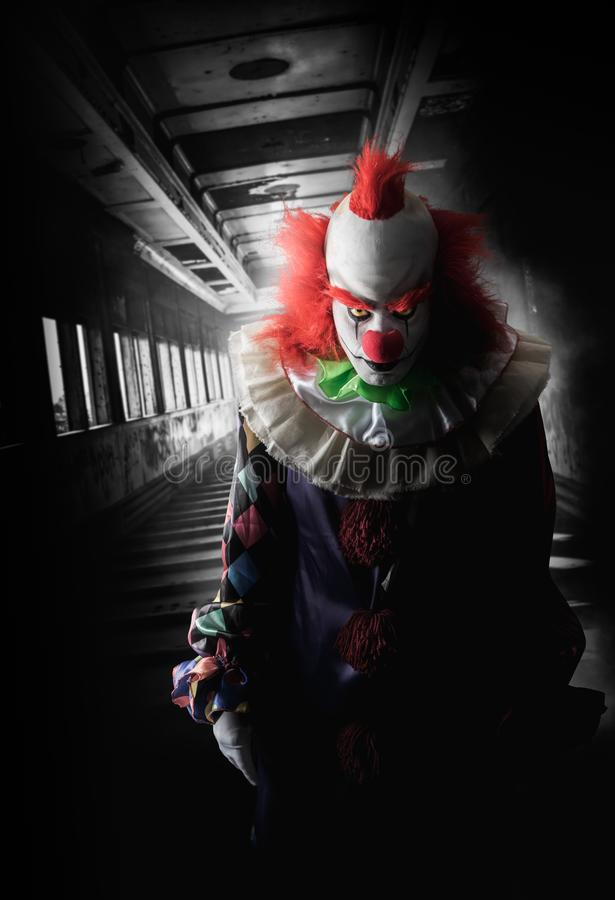 Scary clown on a dark background royalty free stock photo