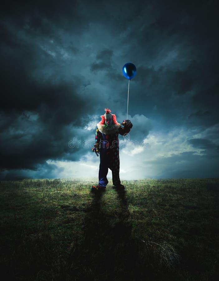 Scary clown on a dark background stock photos