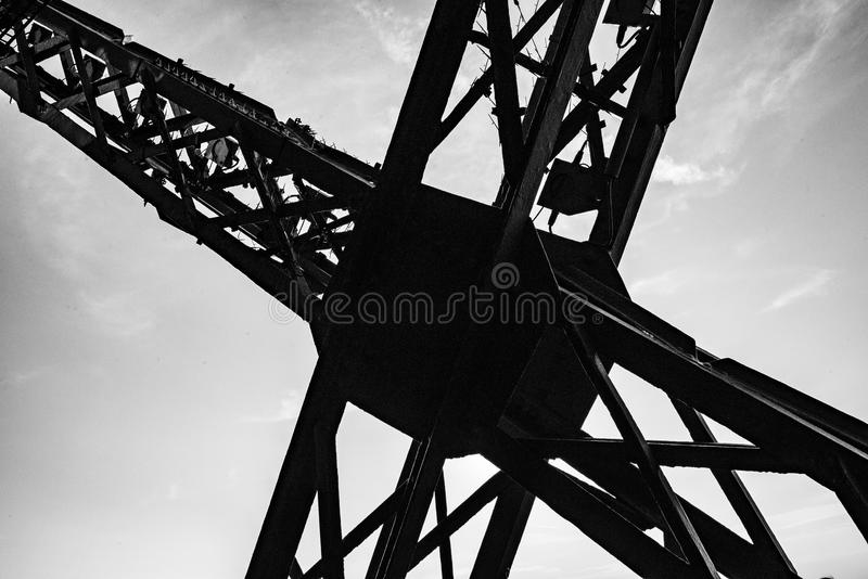 High contrast photo reveiling the metal structure cross on the eiffel tower. Detail of a metal structure from the eiffel tower stock images