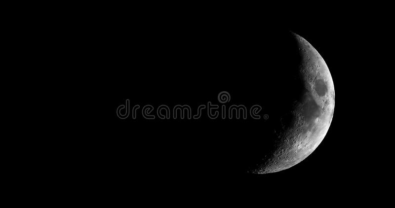 High contrast Waxing crescent moon seen with telescope. High contrast Waxing crescent moon seen with an astronomical telescope - 4K format in black and white ( stock photo