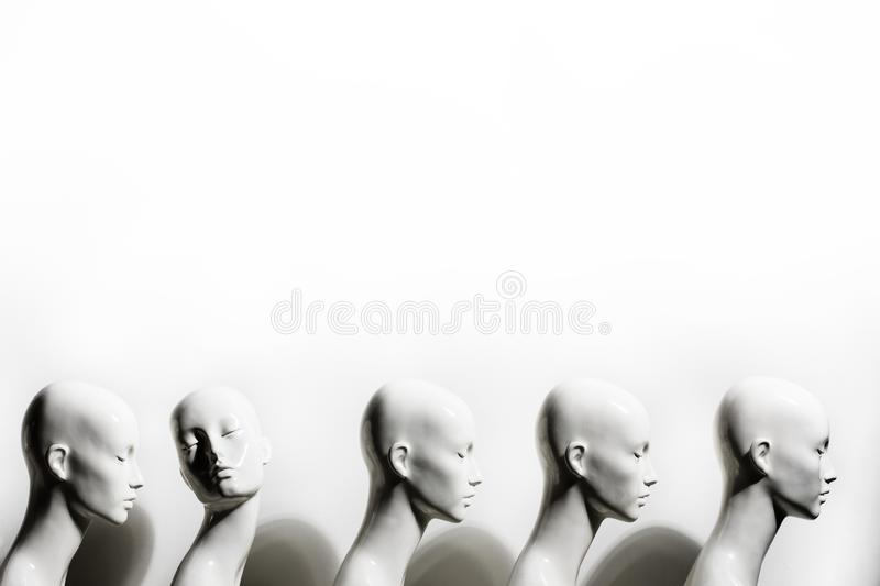 High Contrast Woman Mannequins Standing in The Line royalty free stock photos