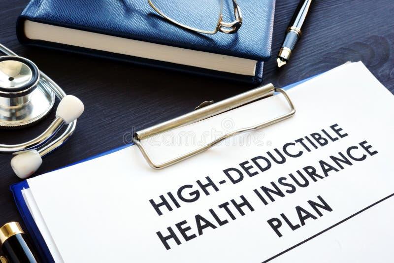 High-deductible health insurance plan HDHP on a desk. High-deductible health insurance plan HDHP on the desk stock photos