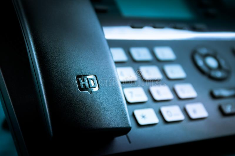 High Definition HD IP desk telephone. Close-up photo of handset on an HD - High definition IP desk telephone stock photography