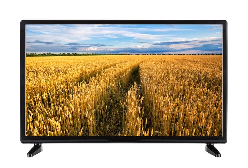High-definition television with road in wheat ears on screen. Modern high-definition television with road in ripe wheat ears on the screen. Isolated on white royalty free stock photo