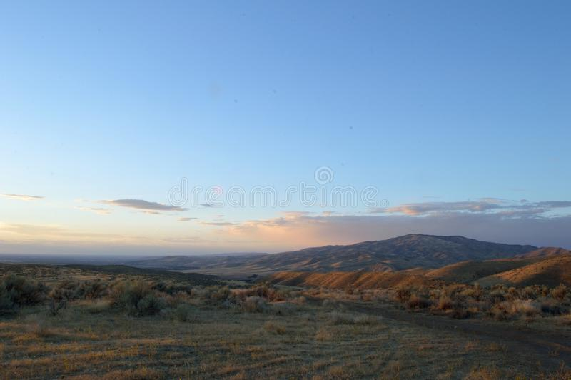 High Desert Hills Sunset Clouds Landscape. Golden Hour with sunset blush colors in the clouds over the high desert foothills at Bonneville Point Route of the royalty free stock photography