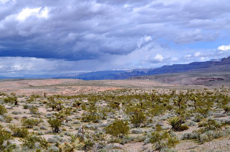 High Desert and Low Clouds. High desert with low clouds ready to meet. At the beginning of a storm setting in over the Northern Arizona high desert in Meadeview royalty free stock image