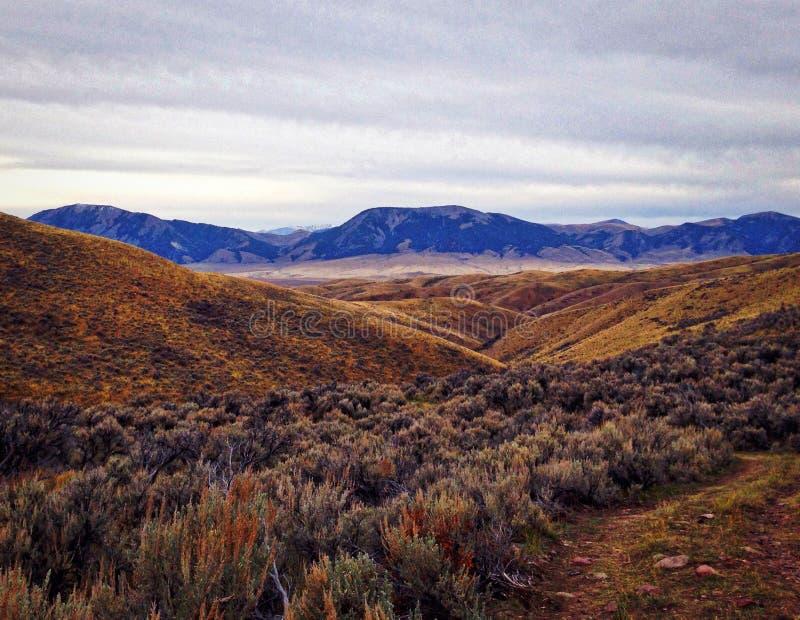 High Desert near Lima, Montana. High desert, sage, mountains in distance, rolling hills, overcast sky, coming storm, near Lima, Montana stock photo