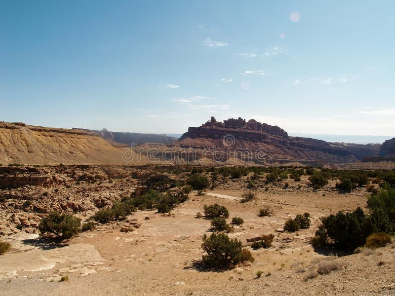 High Desert. Sand and vegetation spreads toward mesas on the horizon in the Colorado National Monument royalty free stock photography