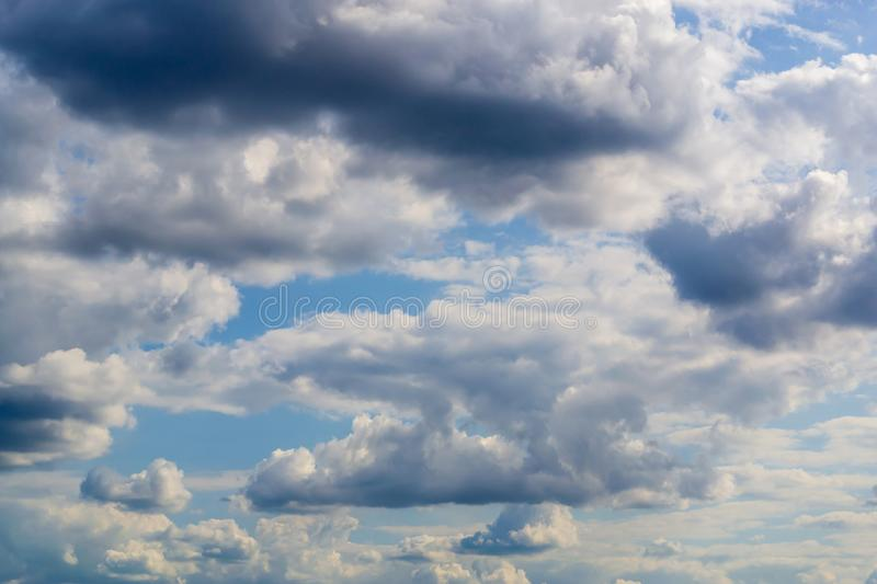 High detail fluffy clouds on blue sky background royalty free stock photos