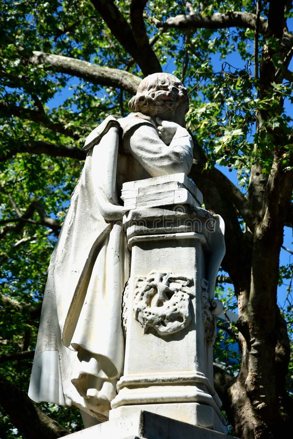 High dynamic range HDR Statue of William Shakespeare built in 1874 in Leicester Square in London, UK royalty free stock photo