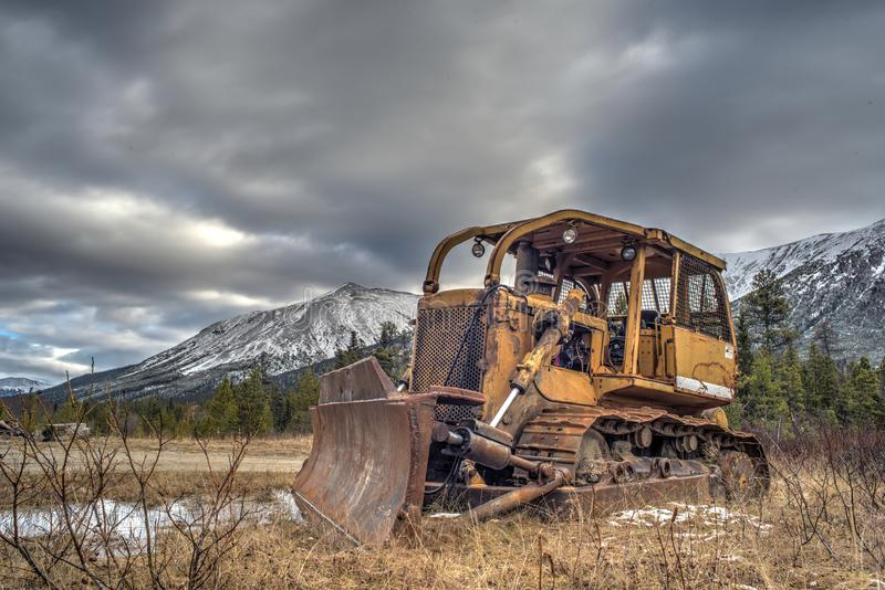 Abandoned Bulldozer. High dynamic range image of an old abandoned industrial bulldozer in a stunning landscape royalty free stock photography