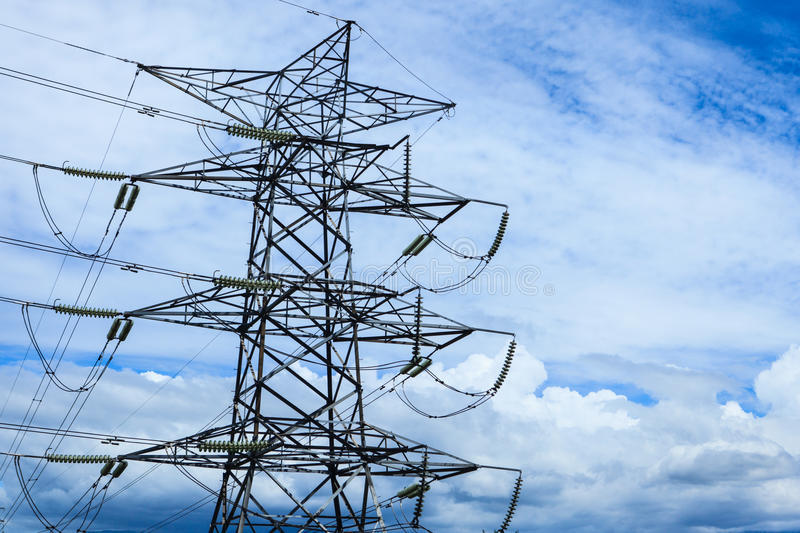 High Electric Pole. Electric pole with wires on a background of blue sky royalty free stock image
