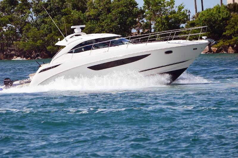 High-end Cabin Cruiser Returning to It`s Home Port. High-end cabin cruiser returning to its home port at a marina in Miami Beach,Florida stock image