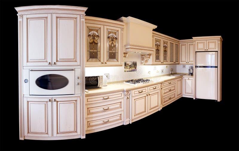 High-end luxemeubilair binnenland van hoekig modern meubilair voor een keuken in klassieke stijl witte boom met gouden versiering stock afbeeldingen