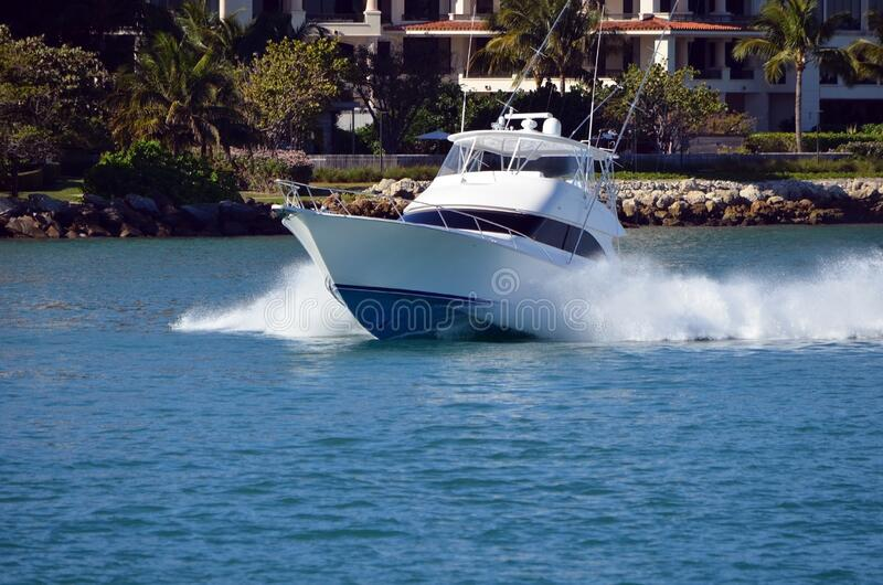 High-end sport fishing boat headed towards the open ocean royalty free stock image