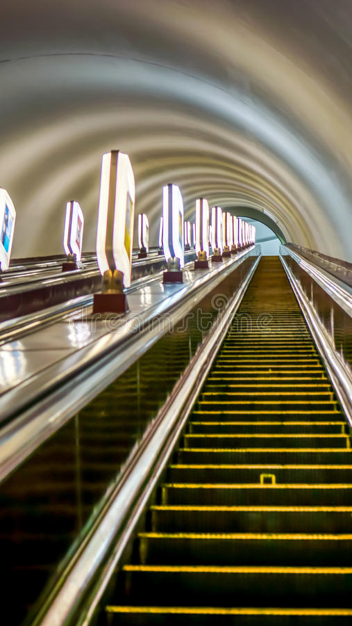 High escalators of the subway in big city royalty free stock photography