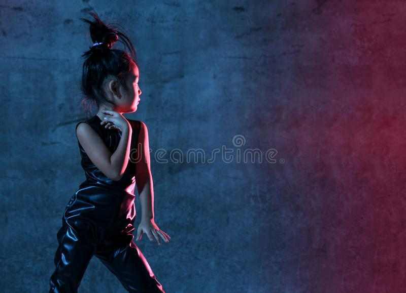High Fashion asian model girl in colorful bright neon uv blue and purple lights colorful make up stock images