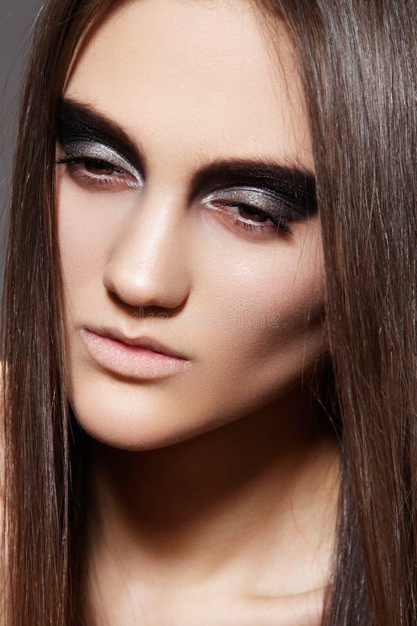 High fashion female model. Evening glitter make-up stock image